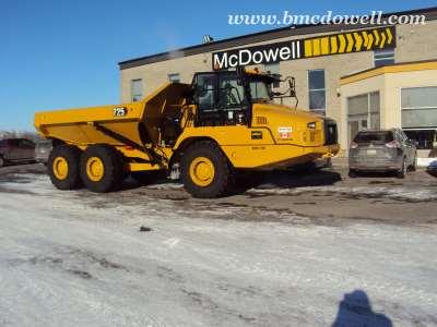 Caterpillar Articulated Rock Truck -  725